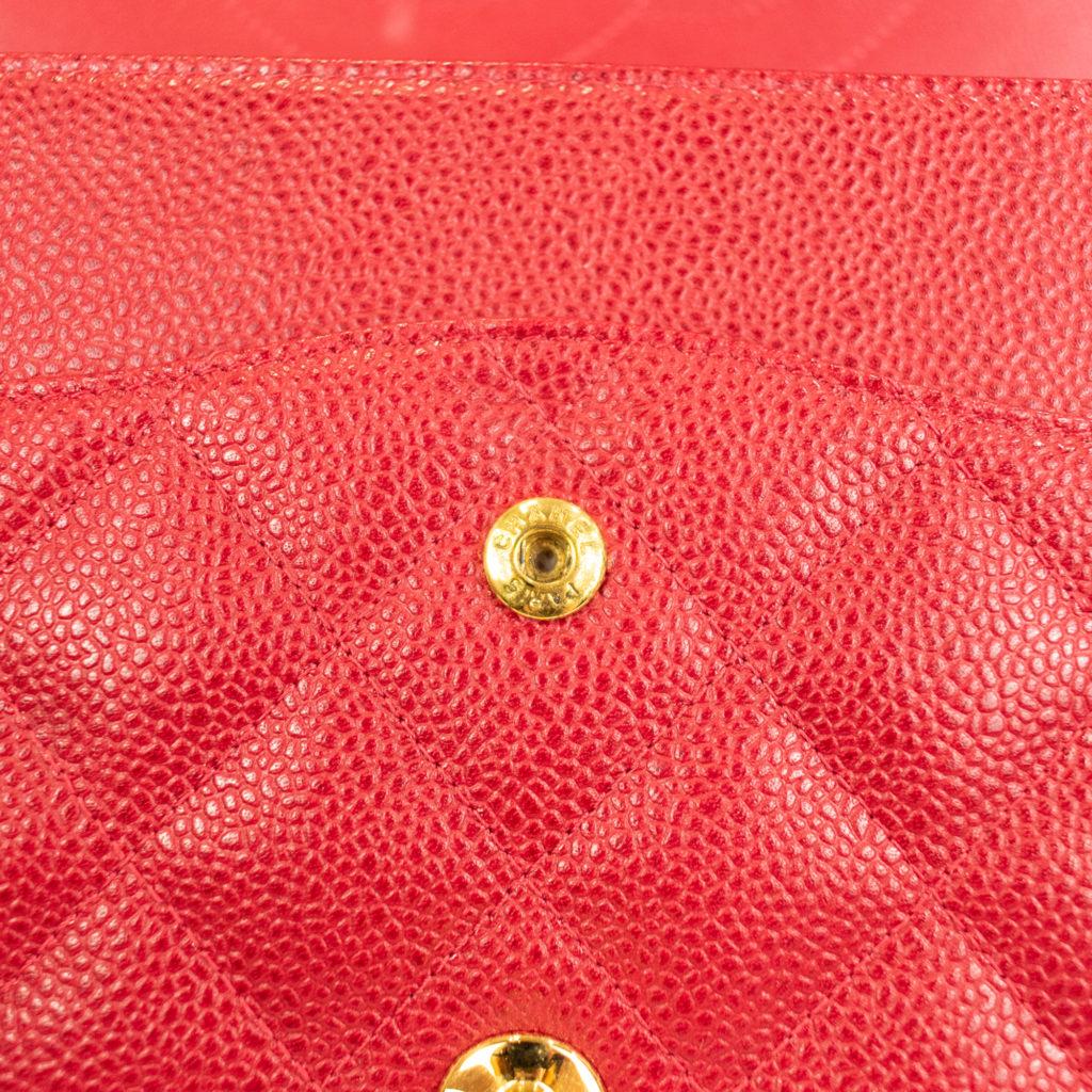 Chanel counterfeit snap closure hardware