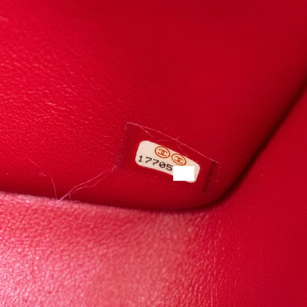 fake serial sticker on superfake Chanel handbag
